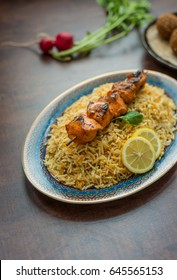 Chicken kebab and biryani rice. An authentic asian food and recipe.