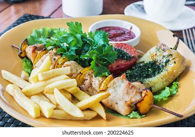 chicken kebab and grilled vegetables