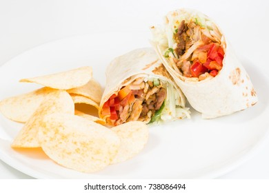 Chicken Kebab with potato chips close up