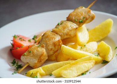 chicken kebab with potatoes