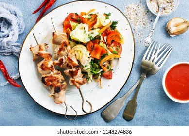 chicken kebab with salad, kebab with sauce and salad