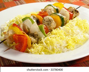 Chicken kebabs with bell peppers, onions, zucchini, and cherry tomatoes. Served with saffron flavored basmati rice.