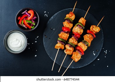 Chicken kebabs with vegetables and greek yogurt sauce. toning. selective focus