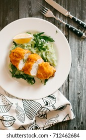 chicken Kiev with mashed potatoes and broccoli