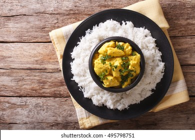 Chicken Korma of coconut and cream sauce served in a rice. horizontal view from above