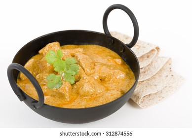 Chicken Korma - Chicken on a mildly spiced creamy sauce served with chapattis.. Indian cuisine.
