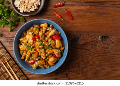 Chicken kung pao. Fried chicken pieces with peanuts and peppers. Top view. Flat lay.