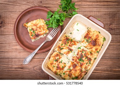 Chicken lasagna and white cheese .