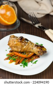 Chicken legs with glazed carrots and orange