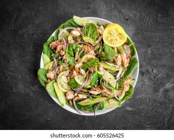 Chicken lemon herb salad with spinach sliced almonds snow peas onions and other great veggies