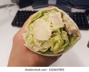 chicken and lettuce wrap with tortilla and computer
