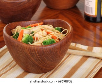 Chicken lo mein with carrots and broccoli in a bowl