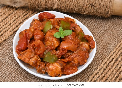 Chicken manchurian / chilli chicken, red hot and spicy curry Mumbai India. Popular North Indian side dish with gravy for chapati / roti/ naan/ paratha / fried rice / pulao. Chinese cuisine.