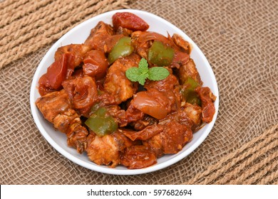 Chicken manchurian / sweet chilli chicken, mild hot and spicy curry Delhi India. Popular North Indian side dish with gravy for chapati / roti/ naan/ paratha/ fried rice/ pulao. Chinese/Thai cuisine.