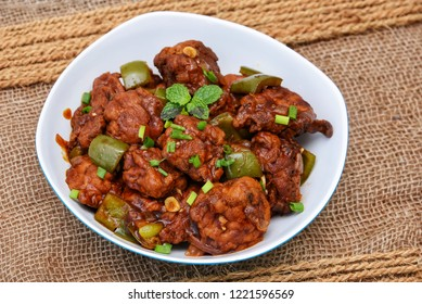 Chicken manchurian or sweet chilli chicken, red hot and spicy curry Mumbai, Delhi India. Popular North Indian side dish for chapat, roti, naan, paratha, fried rice, pulao. Indo Chinese cuisine.