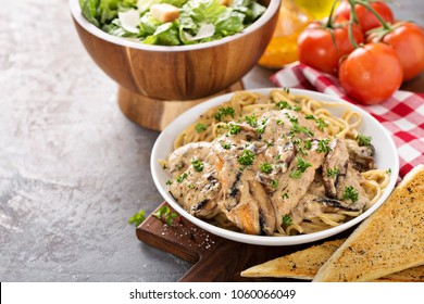 Chicken marsala with mashrooms and linguine pasta