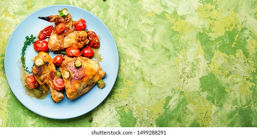 Chicken meat stewed in tomatoes, okra and spices.Space for text