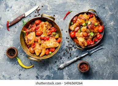 Chicken meat stewed in tomatoes and okra.Appetizing chicken meat grilled barbecue with spices and vegetables