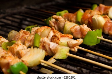 Chicken meat and vegetables on barbecue sticks - shallow depth of field