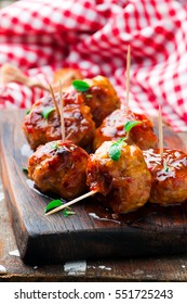 Chicken Meatballs with glaze.selective focus.rustic style