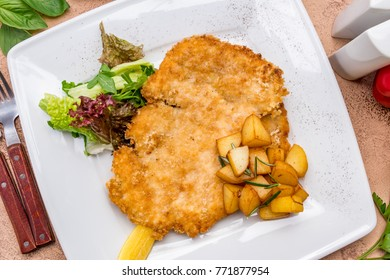 Chicken Milanese with potatoes