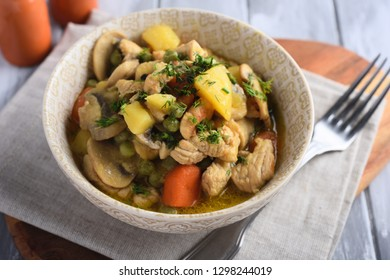 Chicken and Mushroom Fricassee with potato, carrot, green peas, and dill