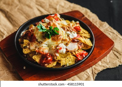 chicken nachos corn chips with white beans with cheese mozzarella and salsa