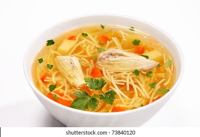 Chicken noodle soup - broth, isolated on white background
