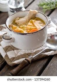 Chicken noodle soup in ceramic pot, selective focus