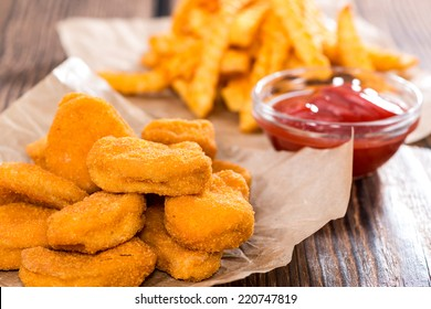 Chicken Nuggets with French Fries (detailed close-up shot)