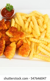 Chicken nuggets with french fries on a plate