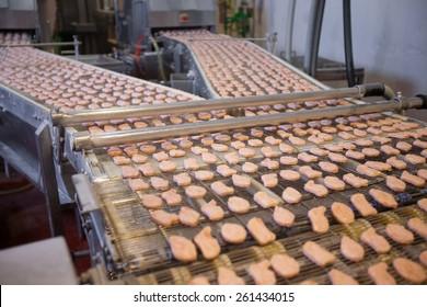 Chicken Nuggets on a Conveyor Belt