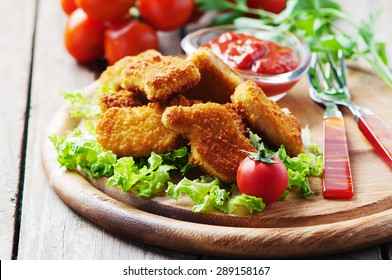 Chicken nuggets on the wooden table, selective focus