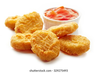 Chicken nuggets and sweet chili sauce isolated on white background