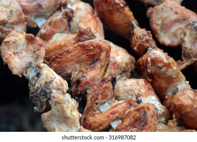 Chicken on the grill to cook
