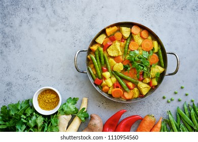 Chicken (or turkey) stew with seasonal vegetables and curry. Batat, parsnip, green peas, carrots, red bell and herbs. The concept of healthy food