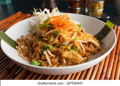 Chicken pad Thai dish of stir fried rice noodles with a contemporary presentation.