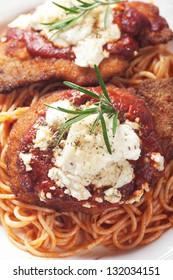 Chicken parmesan, breaded chicken steak with tomato sauce and spaghetti pasta