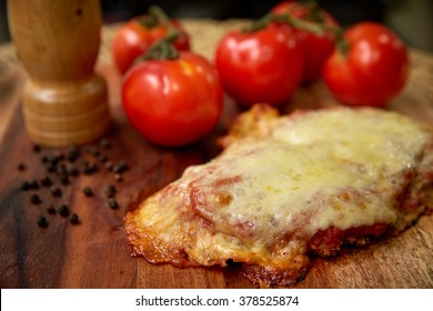 Chicken Parmigiana with tomatoes