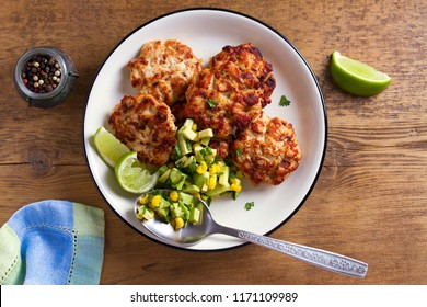 Chicken patties or  burgers with avocado corn salsa. View from above, top studio shot