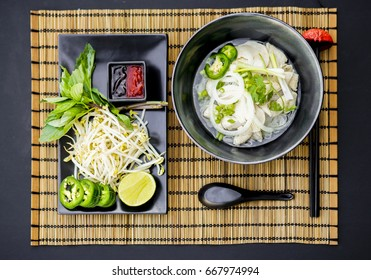 Chicken pho is a famous Vietnamese traditional food, in which, rice vermicelli served with well done chicken and hot tasty soup and fresh vegetable.
