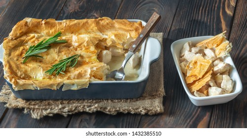 Chicken pie with philo on the wooden table