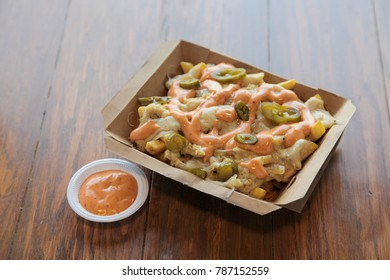 Chicken Poutine fries with mustard ranch chipotle sauce