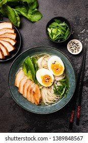 Chicken Ramen Soup In Bowl With Egg. Table Top View. Black Concrete Background. Asian Cuisine