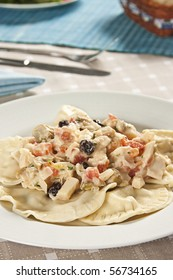 Chicken ravioli with sauce of palmetto. Food photography. Italian cuisine accompanied by palmetto sauce and chicken.
