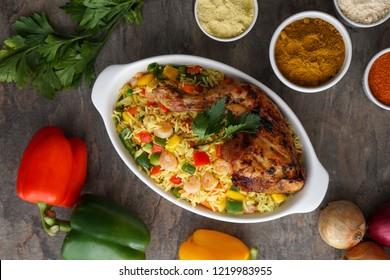 Chicken and Rice African Food dish Nigerian Food Image Green and Red Peppers Dish