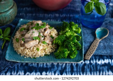 Chicken and rice with broccoli on a blue plate