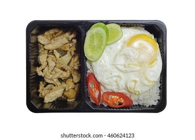 Chicken rice with Fried egg in plastic food box on White Background