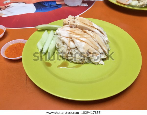 Chicken Rice in green plate.