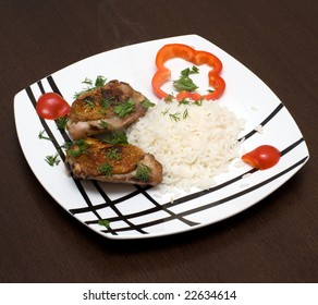 Chicken with rice on a plate